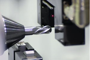ANCA uses laser gages fitted inside its grinding machines and feeds data to its own controllers for precise in-process compensation.