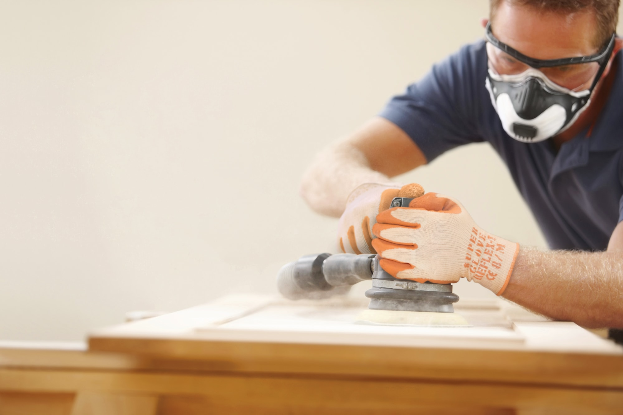 Sanding down a kitchen cupboard door