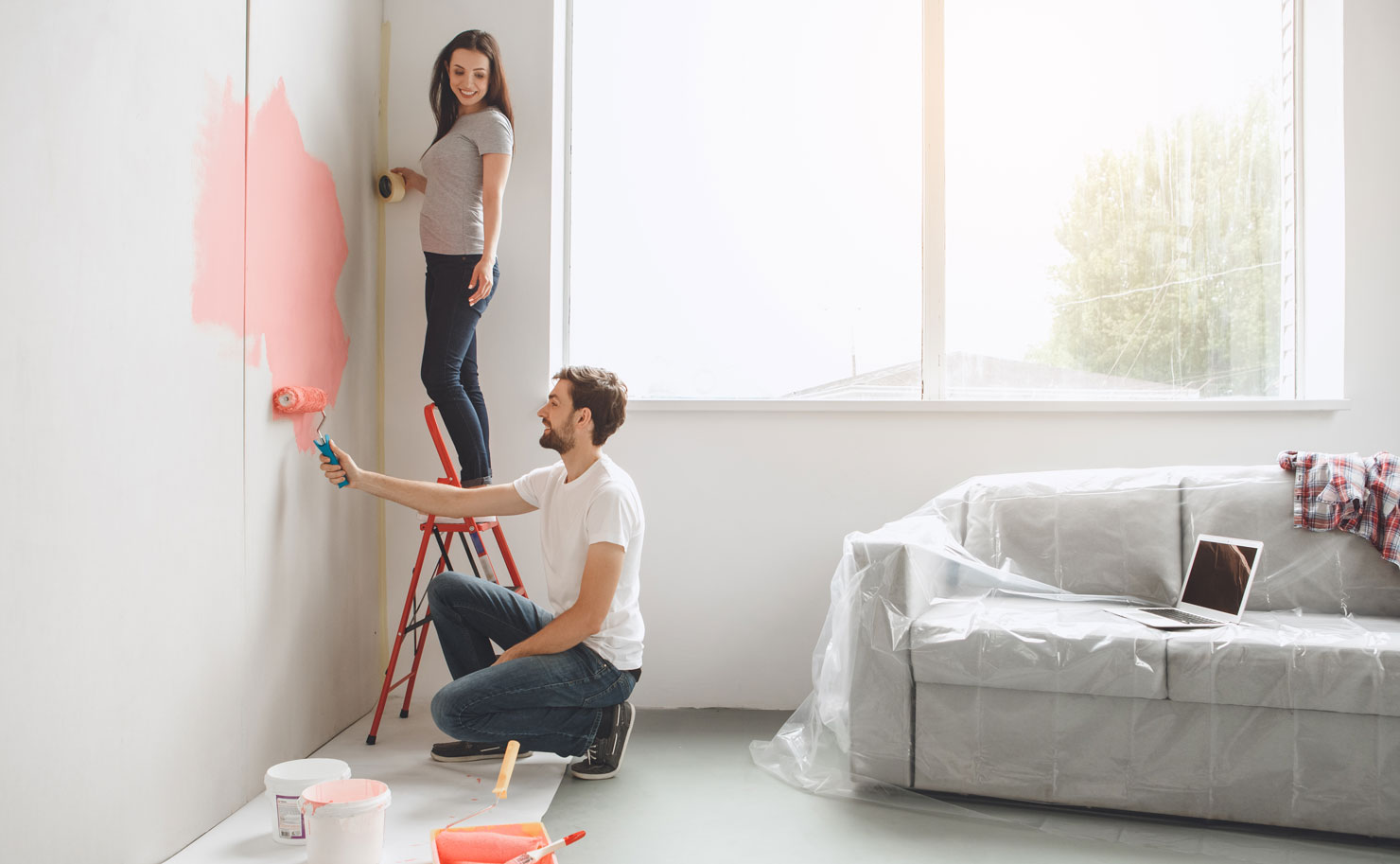 Man and woman preparing to decorate room