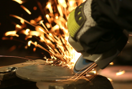 Right angle grinder grinding steel