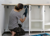 Lady removing kitchen cupboards